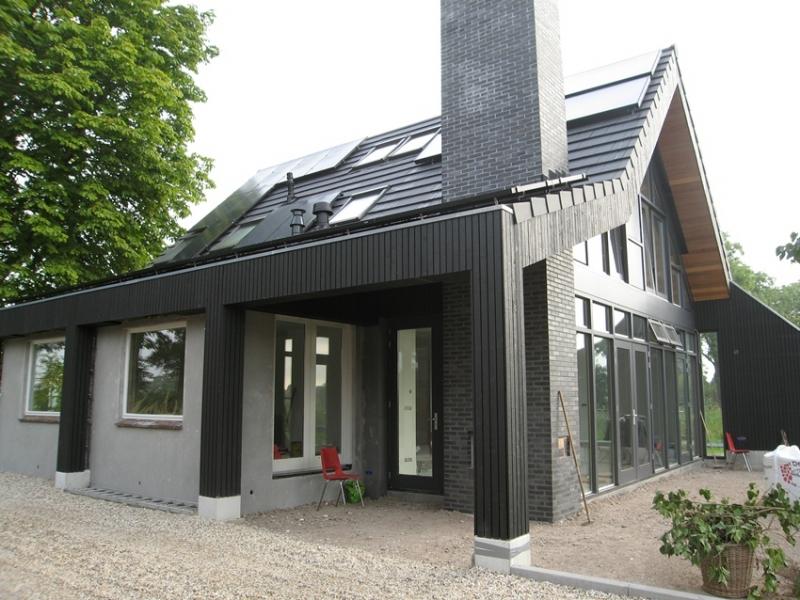Woning met veranda gebouwd over bestaande Woning Zonnepanelen op dak