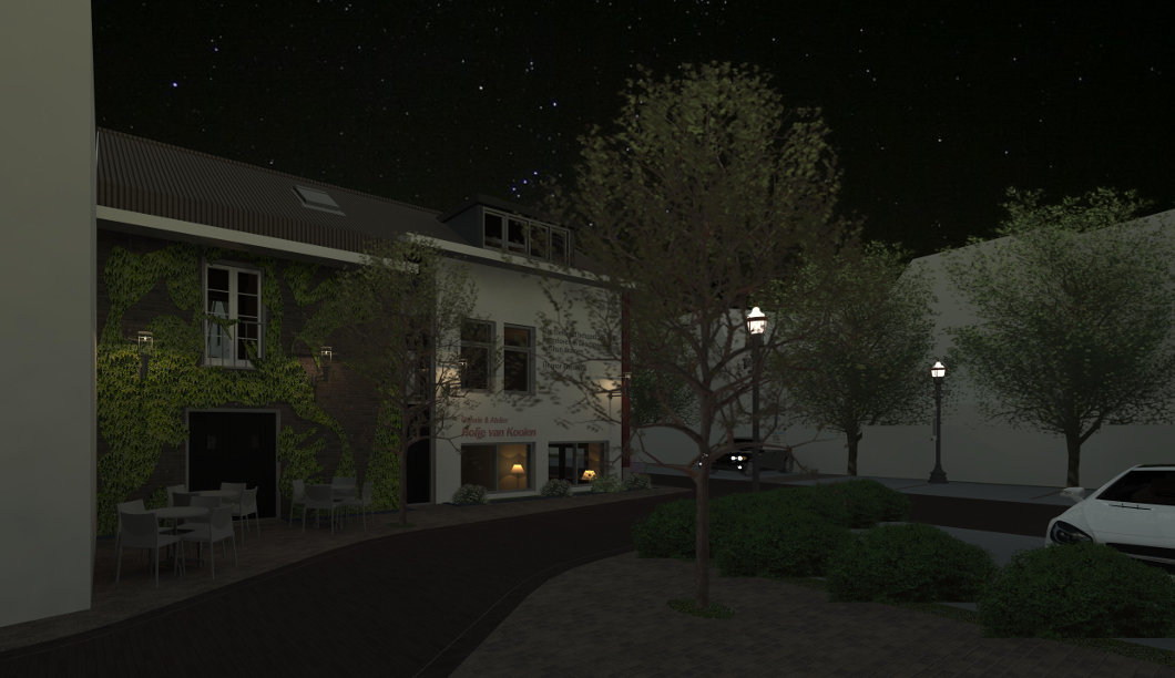 Nachtelijk tafereel van het sfeervolle zwerfgebied Het Hofje van Koolen, gezien vanuit de Gasthuispoort.