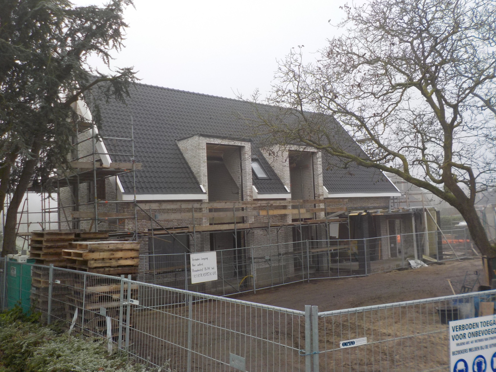 Woonvilla 1 miljoen Vlijmen Heidijk aanzicht zijgevel met entree portaal